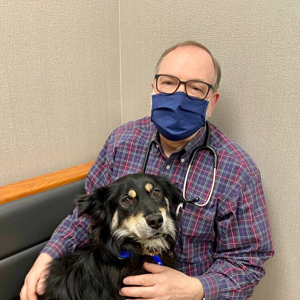 Sadie with her new friend, Dr. Siegle, at Breton Village Animal Clinic in Grand Rapids, MI